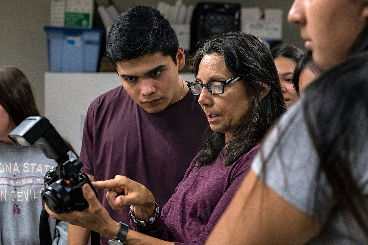 professor teaching student about photography and cameras